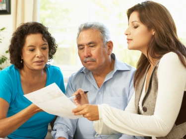 Couple reviewing finances with an advisor