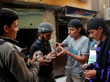 Free Syrian Army fighters prepare homemade bombs in the Aleppo district of Salaheddine September 30, 2013