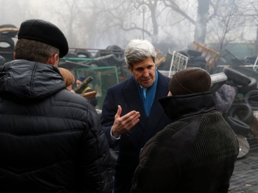 U.S.Secretary of State John Kerry stands beside a barricade at the Shrine of the Fallen in Kiev, Ukraine March 4, 2014