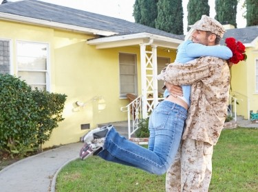 wife welcoming soldier home on Army leave