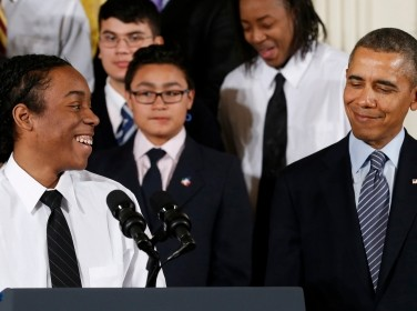 "U.S. President Barack Obama is introduced to speak by Christian Champagne from Chicago at the unveiling of Obama's ""My Brother's Keeper"" initiative"