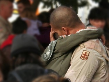 soldier hugging friend