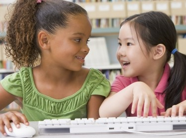 Kindergarten girls using computer