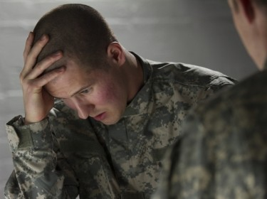 Distressed soldier with counselor