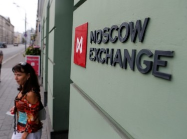 A woman walks out of the office of the Moscow Exchange in Moscow, August 1, 2014