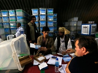 Afghan election workers count ballot papers for an audit of the presidential run-off in Kabul August 27, 2014