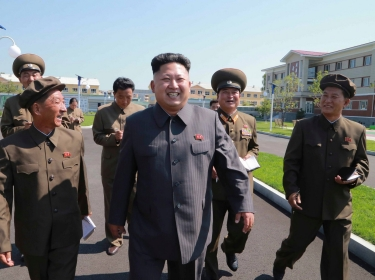 North Korean leader Kim Jong Un gives field guidance at the October 8 Factory in this undated photo released by North Korea's Korean Central News Agency in Pyongyang August 31, 2014