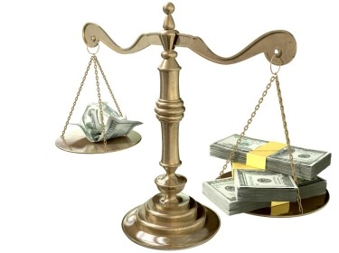 A justice scale with more money on one side than the other