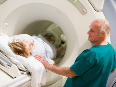 A doctor with a patient preparing for a computerized tomography (CT) scan