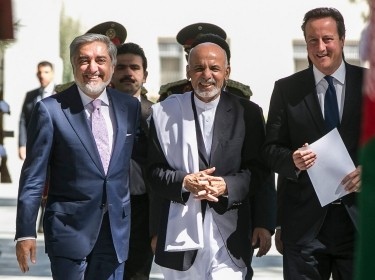 Afghanistan's CEO Abdullah Abdullah and President Ashraf Ghani walk with Britain's Prime Minister David Cameron at the Presidential Palace in Kabul, October 3, 2014