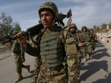 Afghan National Army soldiers walk at the Forward Base in Nari district near the army outpost in Kunar province, February 24, 2014