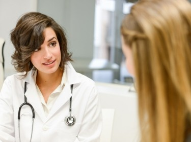 Doctor explaining diagnosis to her female patient