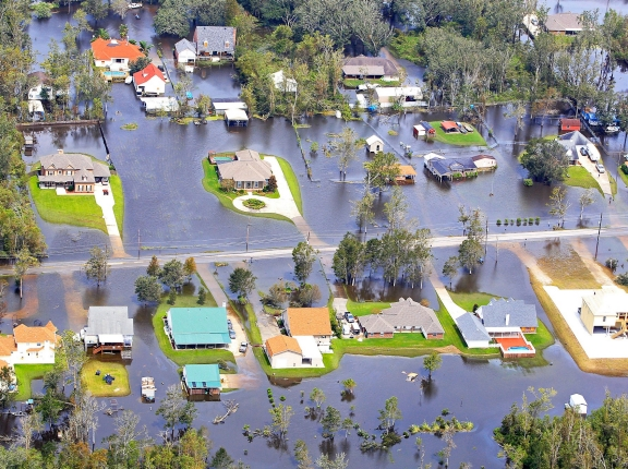 Flood waters from Hurricane Isaac partially submerge homes in Lafitte, Louisiana neighborhoods in August 2012, photo by Sean Gardner/Reuters