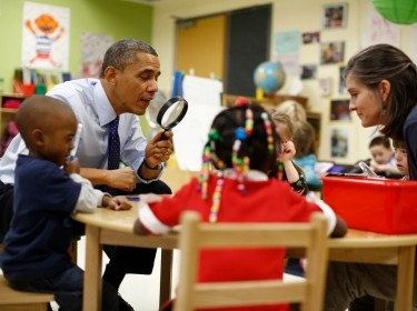 U.S. President Barack Obama playing a game with children in a pre-kindergarten classroom