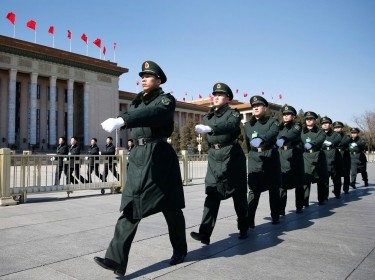 PLA soldiers march ahead of the opening session of the Chinese People's Political Consultative Conference at Tiananmen Sqaure in Beijing, March 3, 2015