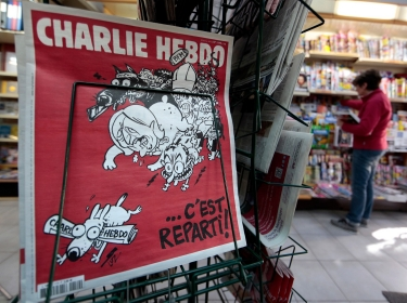 The new issue of satirical French weekly Charlie Hebdo titled 'C'est Reparti' ('Here we go again') in Nice, February 25, 2015