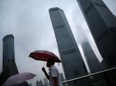 A man walking in the financial district of Pudong in downtown Shanghai