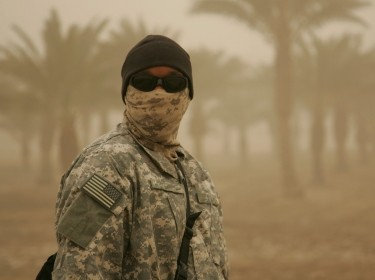 A masked American soldier in a sandstorm in Baghdad, Iraq