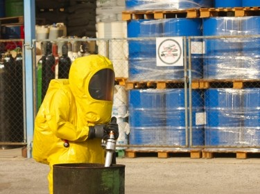 Worker wearing a hazmat suit
