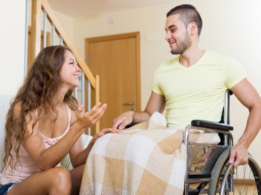 Woman talking to a man in a wheelchair
