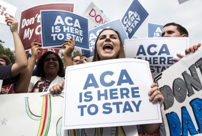 Supporters of the Affordable Care Act celebrate after the Supreme Court ruled in favor of the Obama administration, Washington, DC, June 25, 2015
