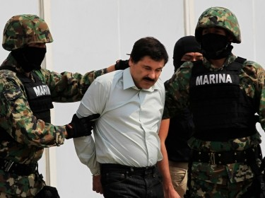 Soldiers escort Joaquin 'El Chapo' Guzman at the Navy's airstrip in Mexico City, February 22, 2014