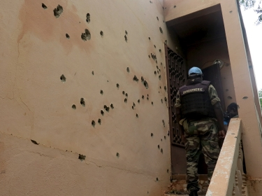 A Malian gendarme climbs stairs at the Byblos hotel, site of a siege over the weekend in which 17 people died in Sevare, Mali, August 11, 2015