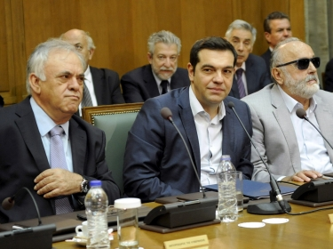 Greek Prime Minister Alexis Tsipras (C) at the first meeting of the new cabinet in the parliament building in Athens, Greece September 25, 2015