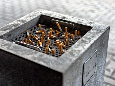 Cigarette butts in a public ashtray