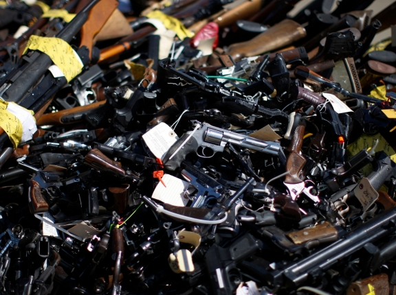 Over 5,000 weapons confiscated from criminals in Los Angeles County and collected through a gun buyback program were  melted and reformed as steel in Rancho Cucamonga, California, July 2013, photo by David McNew/Reuters