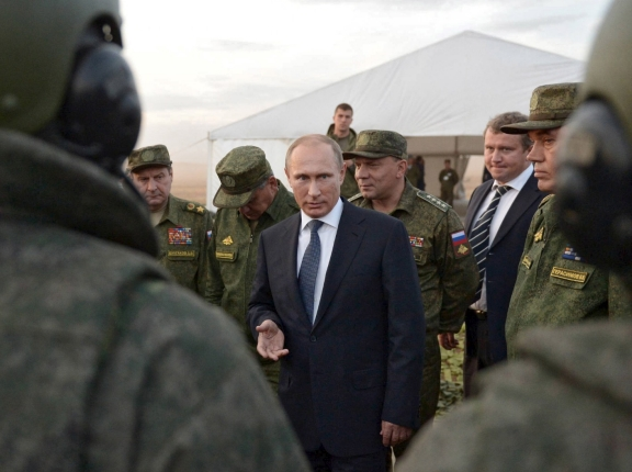 Russian President Vladimir Putin talks to servicemen during a training exercise at the Donguz testing range in Orenburg region, Russia, September 19, 2015, photo by RIA Novosti/Reuters