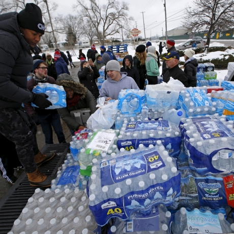 Volunteers distribute bottled water to help combat the effects of the contaminated water crisis in Flint, Michigan, March 5, 2016, photo by Jim Young/Reuters