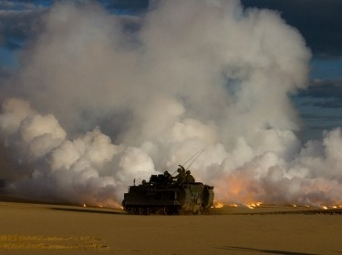 Lithuanian Land Forces fire a smoke screen from an M113A1 Armored Personnel Carrier during a joint exercise with their American partners in Rukla, Lithuania, May 22, 2015