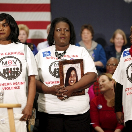 Barbara Hytower, holding a photo of her daughter Jamila who was murdered in Myrtle Beach, stands with other members of South Carolina Mothers Against Violence before the start of a rally, February 25, 2016, photo by Randall Hill/Reuters
