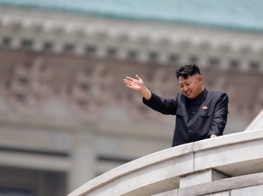 North Korean leader Kim Jong-Un waves during a parade at Kim Il-Sung Square in Pyongyang, July 27, 2013