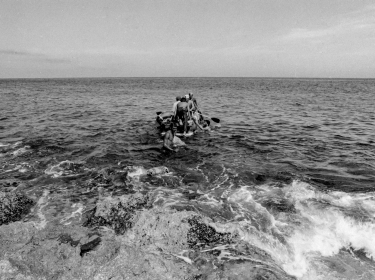 Would-be emigrants launch a makeshift boat into the Straits of Florida towards the U.S., on the last day of the 1994 Cuban Exodus in Havana, September 13, 1994.