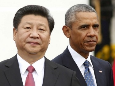 U.S. President Barack Obama (right) stands with Chinese President Xi Jinping during an arrival ceremony at the White House in Washington, September 25, 2015