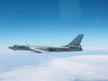 A Chinese military plane H-6 bomber flies over the Pacific October 27, 2013