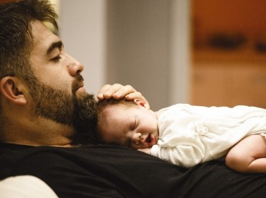 Father and baby asleep