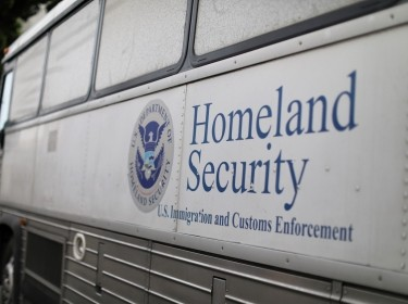 A Homeland Security Immigration and Customs Enforcement (ICE) bus is seen parked outside a federal jail in San Diego, California, U.S. October 19, 2017