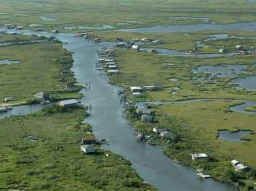 Communities are seen surrounded by water and wetlands in Plaquemines Parish, Louisiana, August 25, 2015