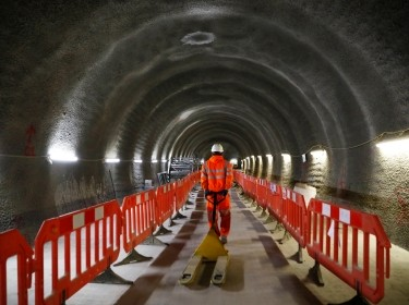 A construction worker drags a trolley down a tunnel at the site for the new Crossrail station in Tottenham Court Road, in London, Britain, November 16, 2016
