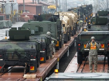 U.S. Army soldiers load military vehicles onto trains at Camp Carroll in Chilgok, South Korea, during the annual Key Resolve/Foal Eagle military exercises, March 6, 2012