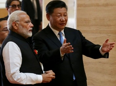 Chinese President Xi Jinping and Indian Prime Minister Narendra Modi talk as they visit the Hubei Provincial Museum in Wuhan, China, April 27, 2018