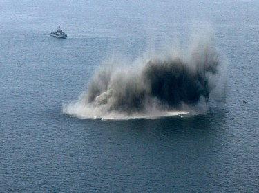 Navy ships guard while a sea mine is destroyed at the Irben Strait in the Baltic sea, near Riga, Latvia, May 20, 2009