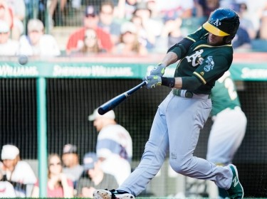 Oakland Athletics second baseman Jed Lowrie hits a home run during the eighth inning against the Cleveland Indians at Progressive Field, July 7, 2018