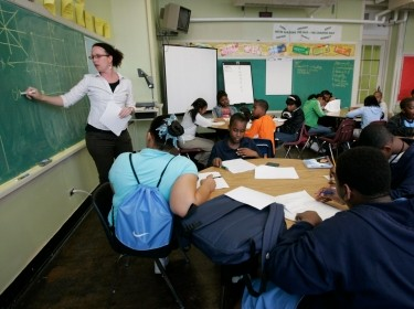 Teacher Darcy McKinnon teaches math to her seventh grade class at Samuel J. Green Charter School in New Orleans, Louisiana, February 22, 2006