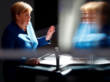 German Chancellor Angela Merkel speaks during a session at the lower house of parliament in Berlin, October 17, 2018