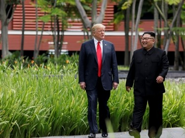 U.S. President Donald Trump and North Korea's leader Kim Jong Un walk at the Capella Hotel on the island of Sentosa, Singapore, June 12, 2018