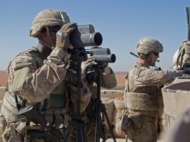 U.S. Soldiers surveil the area during a combined joint patrol in Manbij, Syria, November 1, 2018
